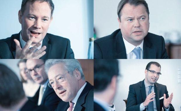 Vier der sieben Diskussionsteilnehmer: Andreas E. Meier, UBS (links oben), Lars Ellermeier, Bethmann Bank (rechts oben), Rainer Heydenreich, UBS (links unten) und Stefan Kirchner, Honestas (rechts unten)
