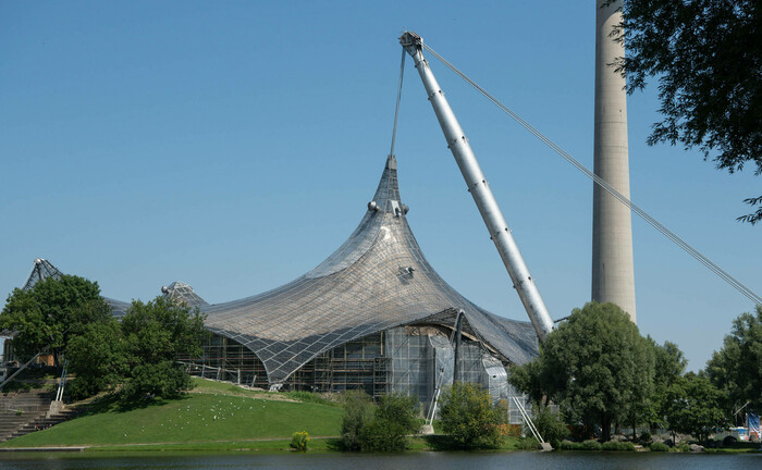 Zahlreiche Experten waren an der Realisierung der berühmten Olympia-Zeltdach-Konstruktion in München beteiligt: Der Anleihemanager Pimco erweitert seine Münchner Niederlassung um drei Kundenbetreuer.  |© imago images / Eibner