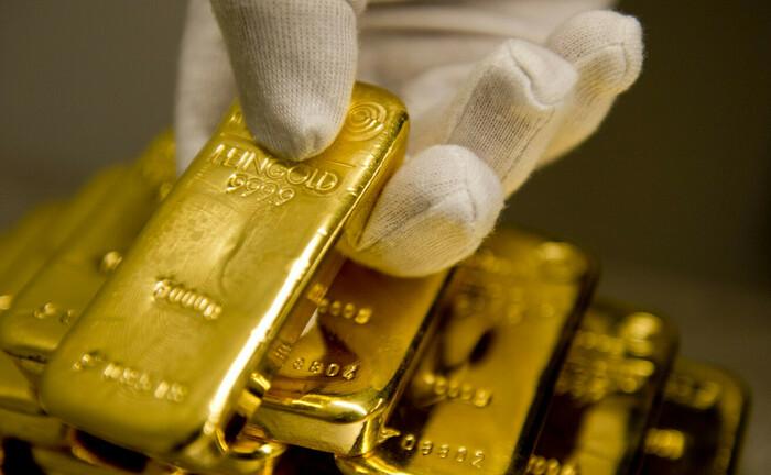 Goldbarren im Tresor eines Münchner Goldhandels: Beim Robo-Advisor Scalable Capital haben Anleger bei zwei neuen nachhaltigen ETF-Strategien die Wahl zwischen Portfolios mit oder ohne Gold-Beimischung.|© imago images / photothek