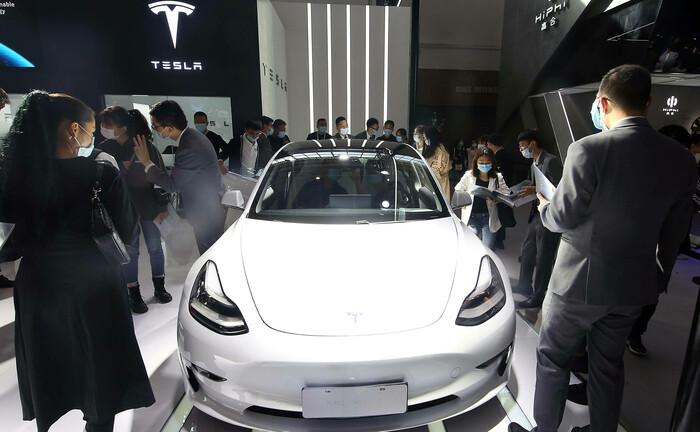 Präsentations von Teslas Model 3 auf der Automobilausstellung in Peking: Vom amerikanischen Elektro-Autohersteller können Banken und Vermögensverwalter in Sachen Innovationsstrategie noch was lernen.